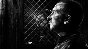 Frank Miller's cameo appearance in Sin City, the film adaptation of his graphic novel series of the same name.  Also pictured, Mickey Rourke as Marv.